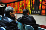 Investors observe stock market at a stock exchange hall in Nanjing, Jiangsu Province of China.