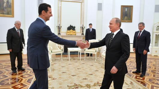 Syrian President Bashar al-Assad meets with Russian President Vladimir Putin at the Kremlin Palace in Moscow, October 21, 2015.