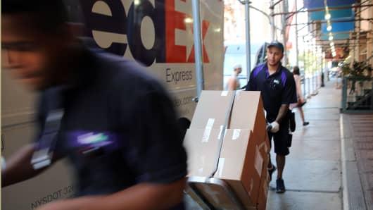 FedEx employees make deliveries in Manhattan.