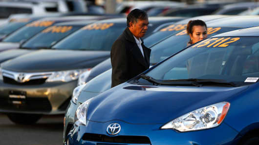 People look at vehicles at AutoNation Toyota dealership in Cerritos, California.