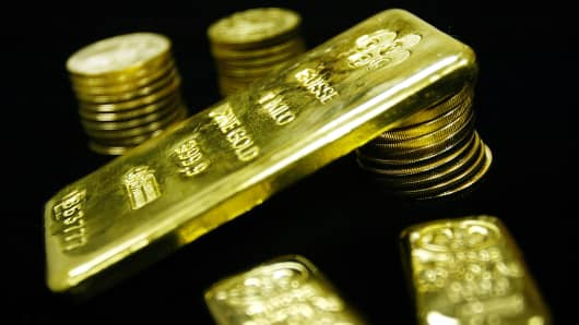 Gold bullion bars and coins.