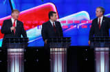 blican presidential candidates Donald Trump (L) and Jeb Bush (R) repond to each other as U.S. Sen. Ted Cruz (R-TX) listens during the CNN Republican presidential debate on December 15, 2015 in Las Vegas, Nevada.