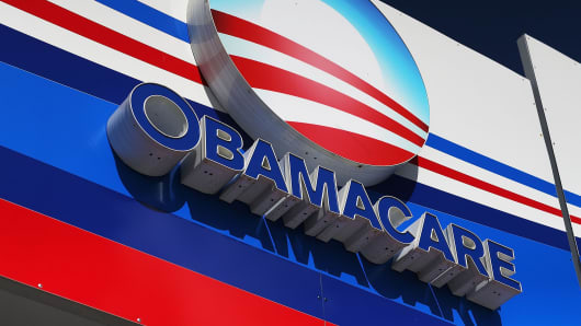 An Obamacare sign is seen on the UniVista Insurance company office in Miami.