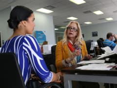 Maria Elena Santa Coloma ,(R) an insurance advisor with UniVista Insurance company, helps Shessy Gonzalez sign up for a health plan under the Affordable Care Act, also known as Obamacare, on December 15, 2015 in Miami, Florida.