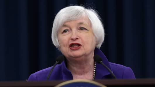 Federal Reserve Bank Chair Janet Yellen holds a news conference where she announced that the Fed will raise its benchmark interest rate for the first time since 2006 at the bank's Wilson Conference Center December 16, 2015 in Washington, DC.