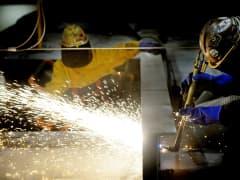 Steel workers at work