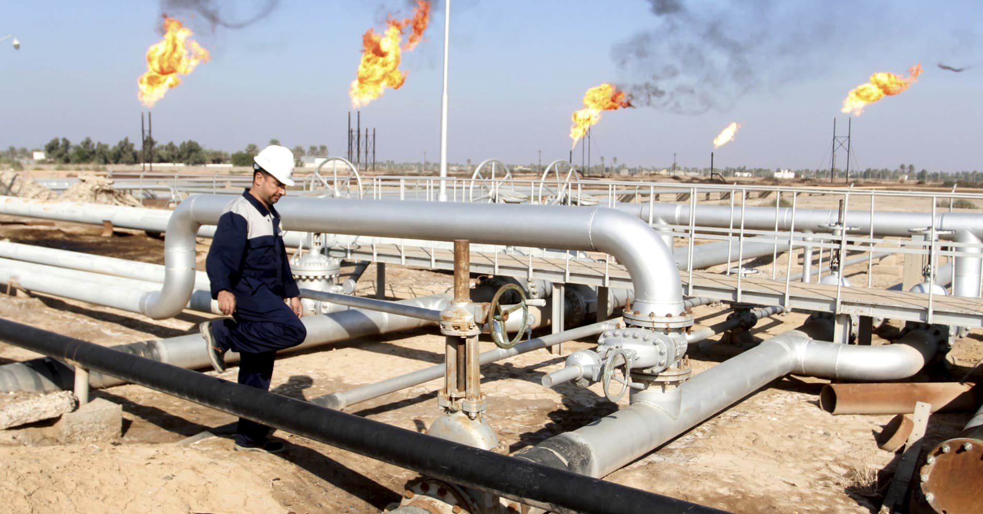 OPEC: Speculators help oil up but oversupply persists