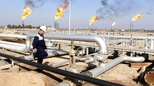 A worker walks at Nahr Bin Umar oil field, north of Basra, Iraq.