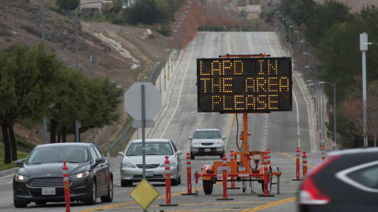 A sign indicates stepped up presence of Los Angeles police officers where many people have left their homes because of a massive natural-gas leak in the Porter Ranch neighborhood of the of the San Fernando Valley region of Los Angeles, on December 22, 2015.