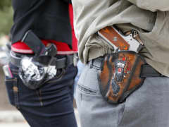 Art and Diana Ramirez of Austin with their pistols in custom-made holsters during and open carry rally at the Texas State Capitol on January 1, 2016 in Austin, Texas. On January 1, 2016, the open carry law takes effect in Texas, and 2nd Amendment activists