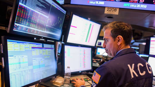 """The floor of the New York Stock Exchange at the closing bell on Oct. 29, 2014, in New York City. The Federal Reserve phased out its bond purchasing program while keeping interest rates near zero for a """"considerable time."""""""