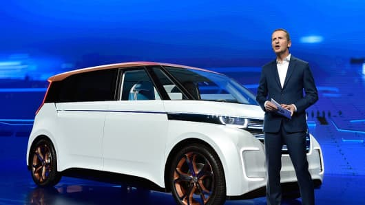 Volkswagen Passenger Cars CEO Dr. Herbert Diess speaks at CES 2016 next to the Budd-e electric van.