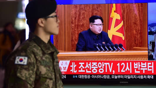 A South Korean soldier walks past a television screen showing a broadcast of North Korean leader Kim Jong-Un's New Year speech, at a railroad station in Seoul on Jan. 1, 2016.