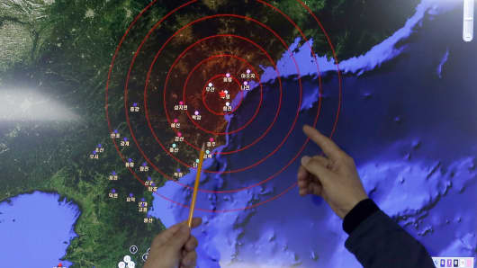 Officers from the Korea Meteorological Administration point at the epicenter of seismic waves in North Korea, at the National Earthquake and Volcano Center of the Korea Meteorological Administration in Seoul, South Korea, on Jan. 6, 2016.