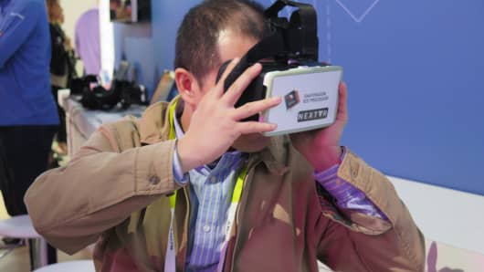 CES attendee tries out the NextVR headset at CES 2016