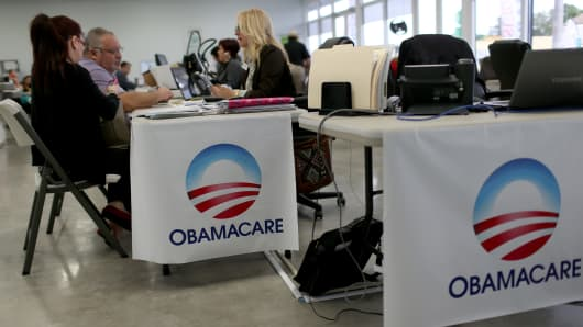 A couple enrolls in Obamacare with an insurance agent in Atlanta.