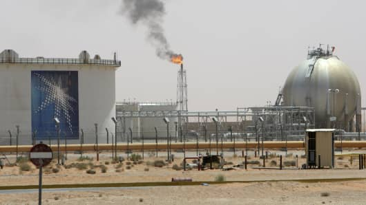 A gas flame is seen in the desert near the Khurais oilfield operated state oil giant Saudi Aramco, about 160 km (99 miles) from Riyadh.