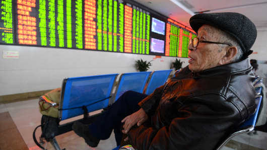 An investor observes stock prices on Jan. 7, 2016, in Fuyang, China.