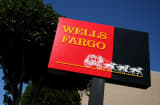 A sign is displayed outside of a Wells Fargo bank in San Francisco, California.