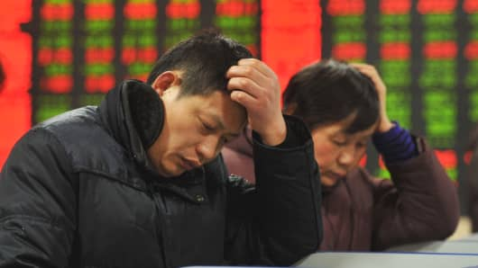 Investors observe stock market prices at an exchange on January 5, 2016 in Fuyang, China.