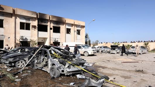 Damaged cars are seen after a truck bomb attack targeting a police training center in Zliten, Libya on January 7, 2016.
