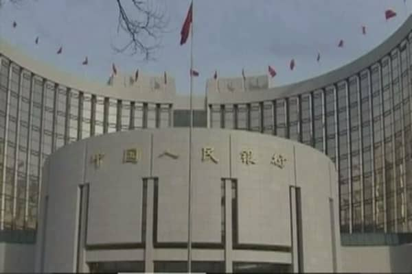 China to further liberalize the yuan, nudges rate higher