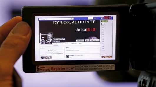 A print screen of the hacked Facebook page of French television network TV5Monde is seen on a camera viewer in Paris April 9, 2015.