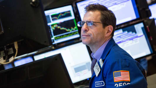 A trader on the floor of the New York Stock Exchange, January 8, 2015.