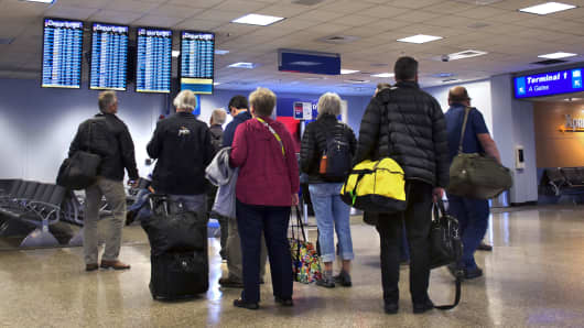 Three charts that show why airlines overbook flights