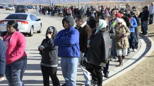 Hundreds of people wait in line to purchase tickets for the Powerball lottery at the CA lotto store in San Bernardino County, California, on the California-Nevada state line January 9, 2016.