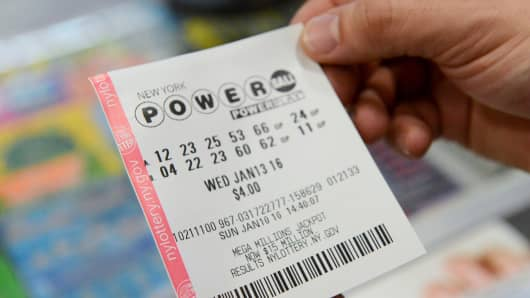 A person in New York holds a Powerball ticket for the January 13, 2016 drawing.
