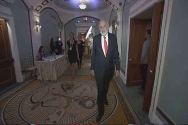 Carl Icahn denies building stake in Time Warner