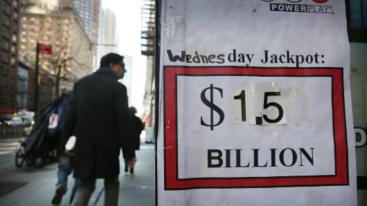 A sign advertises the Powerball jackpot outside of a store on January 13, 2016 in New York City.