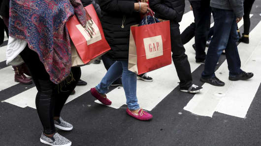 Shoppers carrying GAP bags in New York.