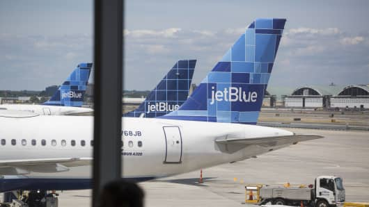 JetBlue planes sit at gates at John F. Kennedy International Airport in New York City.