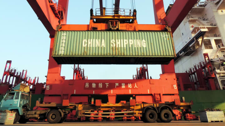 Containers are transported at a port in Lianyungang, eastern China's Jiangsu province on January 19, 2016.