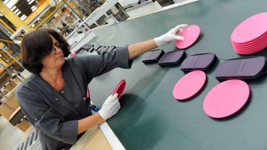 An employee of Tupperware Brands on the production line in Joue-les-Tours, France.