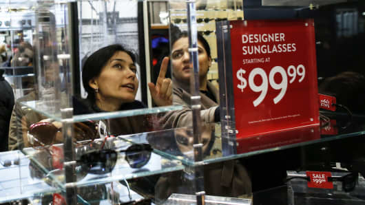 Customers shop in Macy's flagship store in Herald Square, New York.