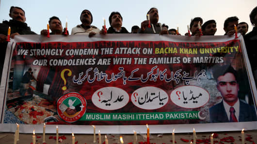 Pakistanis light candles during a vigil for victims of the Bacha Khan university attack in Islamabad, Pakistan.