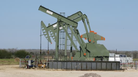 Pump jacks stand idle in DeWitt County, Texas, on Jan. 13, 2016.
