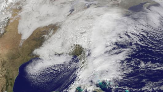 A major winter storm affecting the U.S. East Coast is seen in this visible image from NOAA's GOES-East satellite at 1:30pm ET (18:30 GMT) January 22, 2016.
