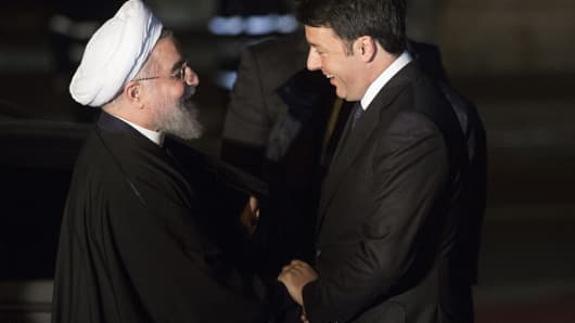 Matteo Renzi, Italy's president, right, greets Hassan Rouhani, Iran's president, before their meeting at Capitol Hill in Rome, Italy, on Monday, Jan. 25, 2016.