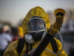 A worker fumigates the Sambadrome ahead of Carnival celebrations in Rio de Janiero, Brazil, on Tuesday, Jan. 26, 2016. The operation is part of the Health Ministry's efforts to eradicate the Aedes aegypti mosquito, which is thought to spread the Zika virus