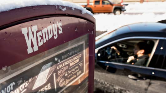 A customer pulls up to the drive-thru speaker outside a Wendy's restaurant in Peoria, Illinois.