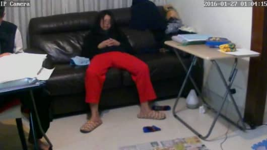 Shodan allows you watch unsecured web cam feeds. Here a woman in Hong Kong is asleep on her couch.