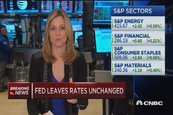 Stocks dip after Fed leaves rates unchanged