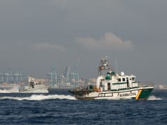 A Spanish Guardia Civil boat patrol the water.