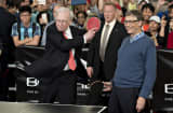 Warren Buffett, chairman of Berkshire Hathaway Inc., left, plays ping pong with Bill Gates, chairman and founder of Microsoft Corp. and a Berkshire Hathaway Inc. director, during a shareholder event on the sidelines of the Berkshire Hathaway Inc. annual sh
