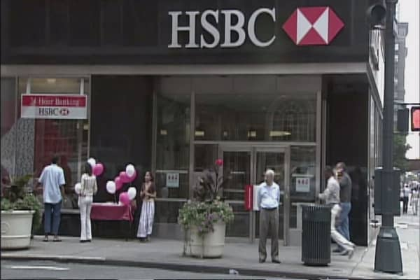 HSBC will freeze salaries and cut costs