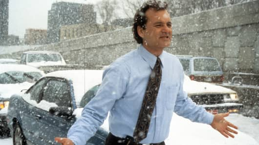 Bill Murray runs through the snow in a scene from the film 'Groundhog Day', 1993.